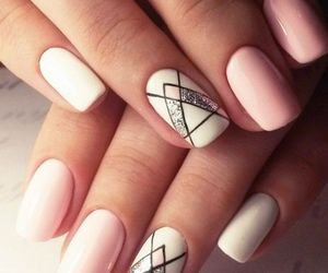 white nails, light pink nails, and drawings on nails image