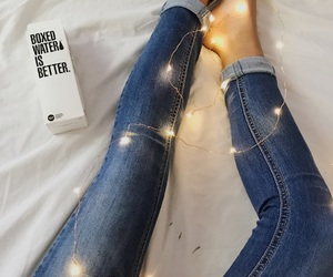boxed water, fairy lights, and jeans image