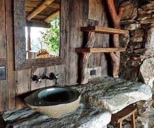 rustic bathroom, log home, and stone work image