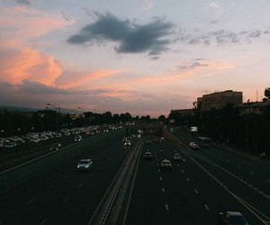 cars, sky, and road image