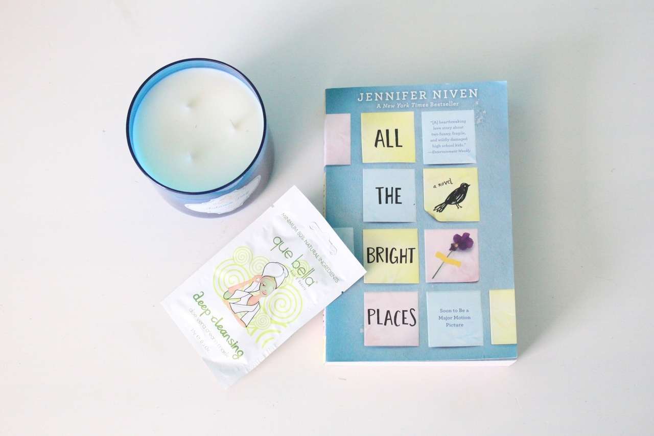 books, candles, and face mask image