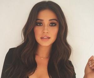 black top, brown eyes, and wavy hair image
