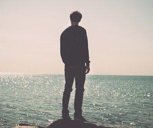 boy, calm, and sea image