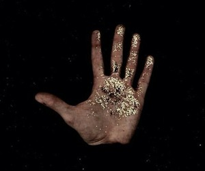 gold, black, and hand image