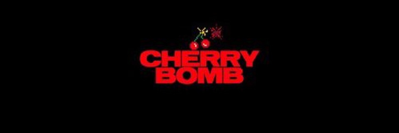 red, cherry, and bomb image