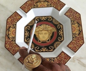 Versace and cigarette image