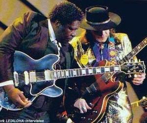 bb king, stevie ray vaughan, and guitar slingers image