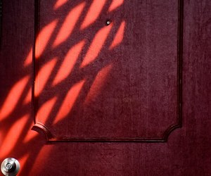 red, shadow, and wall image