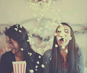 girl, popcorn, and friendship image