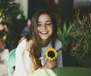 girl, smile, and flowers image