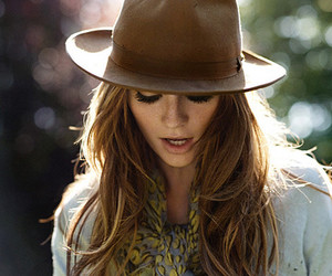 blowing, girl, and hat image