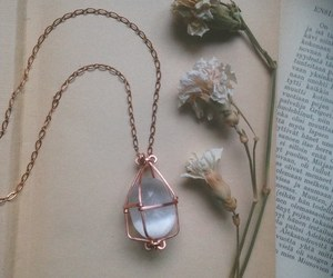 book, flowers, and necklace image
