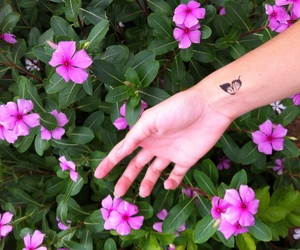 arm, butterfly, and flowers image
