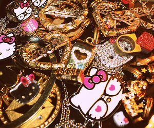 hello kitty, gold, and pink image