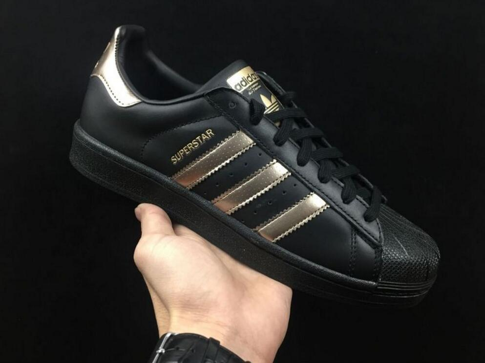 black and rose gold adidas shoes