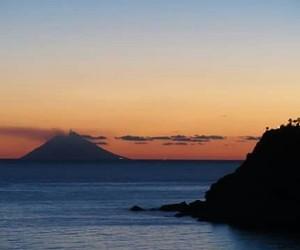 sea, sunset, and vulcano image