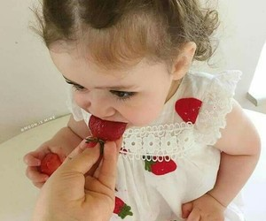 baby and strawberry image
