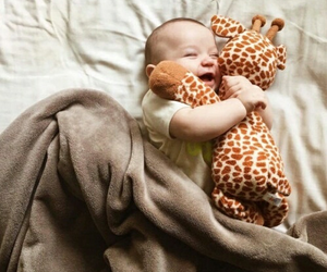 baby, bed, and giraffe image