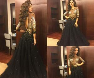 black dress, curly hair, and gold image