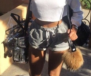 grey shorts, fur keychain, and white crop hoodie image