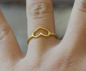 heart ring, cross ring, and hammered heart image