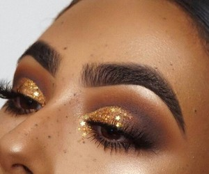 freckles, glow, and makeup image