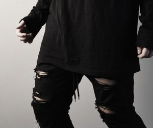 black and ripped jeans image