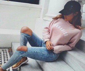 black hat, ripped jeans, and sweater image