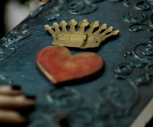 book, crown, and evie image