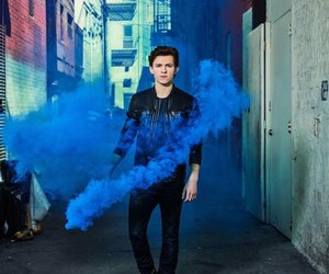 tom holland, blue, and Avengers image