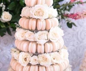 cake, flowers, and macarons image