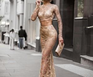 dress, elegance, and gold image
