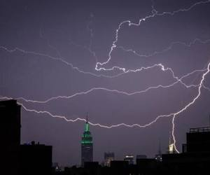 sky, city, and lightning image