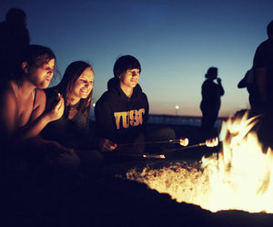 beach, couple, and fire image