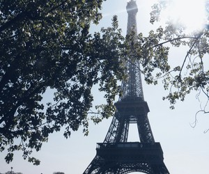 eiffel tower, sunlight, and paris image