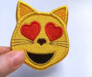 cat, pins, and emoji image