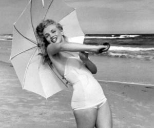 Marilyn Monroe, umbrella, and beach image