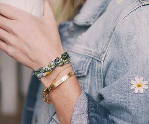 bracelet, denim jacket, and gold image