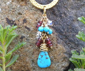 turquoise necklace, turquoise pendant, and turquoise and gold image