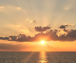 sunset, ocean, and sky image