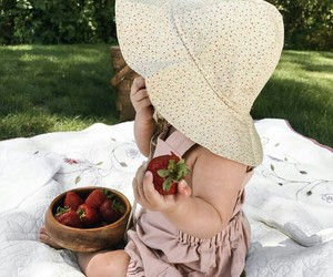 baby and strawberries image