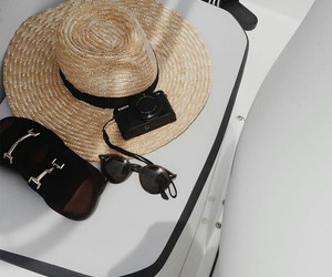 camera, sunglasses, and sunhat image