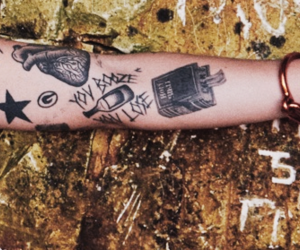 tattos, Harry Styles, and one direction image