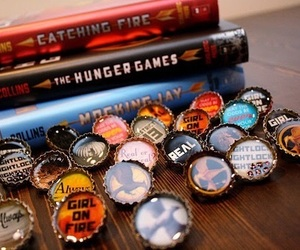 the hunger games, catching fire, and book image
