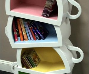 book, cup, and bookshelf image