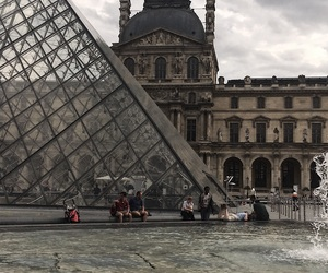 building, louvre, and pyramid image