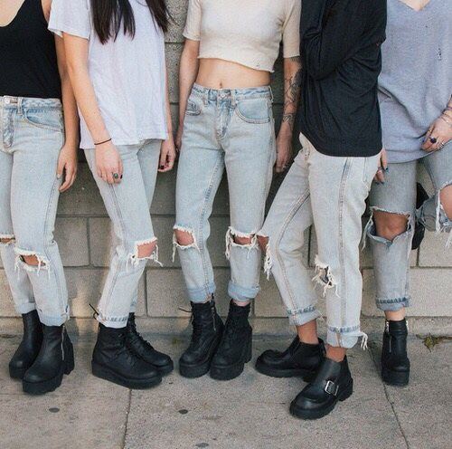 black shoes, jeans, and ripped image