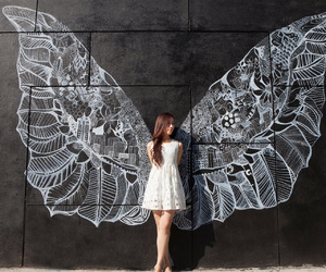girl, mystery, and wings image