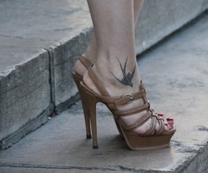 ankle, tattoo, and swallow image
