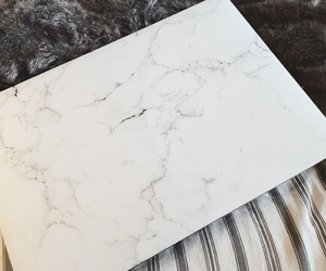 bed, macbook, and marble image